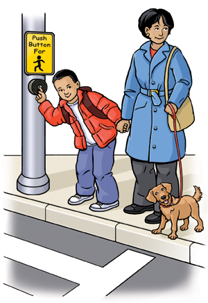 Woman and boy standing at street crossing holding hands. Boy is pressing button to cross street. Woman has dog on leash.